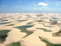 The Lencois Maranhenses, in Brasil is a desert that accumulates lagoons of water in the winter. Click through to find out more and see 8 other amazing deserts of the world. Parc National, National Parks, Gateshead Millennium Bridge, Wonderful Places, Beautiful Places, Go Brazil, Deserts Of The World, World Geography, Natural Wonders