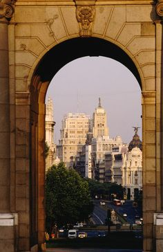 View of Madrid through a classical arch found in many of the city parks (Jonathan Chester)