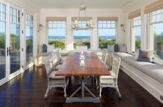Cottage Dining Room with Crown molding, Window seat, French doors, Wall sconce, Hardwood floors, Chandelier