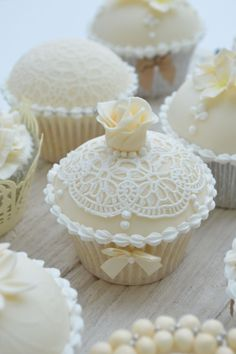 Beautifully detailed cupcakes. Could be done differently. Think a little top hat, a butterfly..... The options are boundless!
