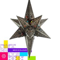 Moravian Star Lamp Punched / Pierced Metal by theMexicolourStore  This aged tin star light with cutout shapes and colored glass marbles makes a remarkable lighting addition to any room.  Add a warm glow to your southwest, rustic, or Spanish colonial decor. Our hanging star lights are all handcrafted by our talented metal craft artists in Mexico.  Natural variations, in the wide array of materials that are used to create each product, make every item a masterpiece of its own.