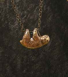 This little sloth is living the high life and dangles freely on a necklace, and is just happy to follow you everywhere. Adorable.  Hand craved from