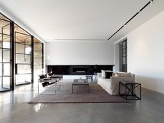 I love the Wassily Chairs in this minimalist, yet contemporary home.