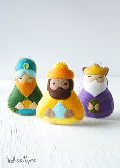 This listing is for an instant-download PDF-PATTERN. It is not a finished toy. Solemn and sweet, the Magi (Three Wise Men) felt ornaments bring old world charm and modern whimsy to your holiday decor. Part of Trellis & Thymes Nativity Pattern Collection! This felt pattern is stitched entirely by hand, and is perfect for beginners. Finished ornaments are approximately 4.75 inches tall.  Skills required: - Basic embroidery skills - Blanket stitch - Back stitch - Stem stitch - Applique stitch…