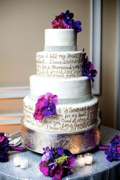Wedding cake with love notes written on it by Tantawan Bloom