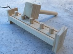 Handcrafted Wooden Peg and Hammer toy made from Pine wood. This version of the toy allows you to hammer the pegs through to the other side. Ayke & WhatNot