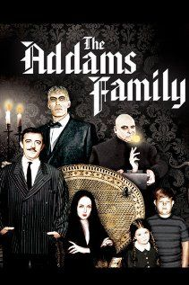 The Addams Family  - I wanted to be Morticia Addams.  This show had a great and creepy theme song.  We used to sing it every Halloween!