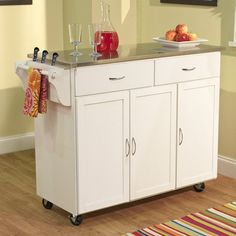 Add extra space and storage to any kitchen with this extra large kitchen cart. Two utility drawer, Three storage cabinet with adjustable shelves, and towel holder and knife block on one side. Available with stainless steel top in a black, white, or espresso finish. Constructed of rubberwood, engineered wood.