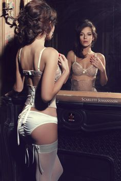 Scarlett Johansson reflecting on her sexy white lingerie