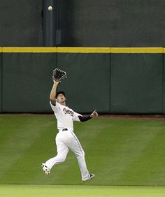 HOUSTON, TX - JUNE 20:  Jordan Schafer #1 of the Houston Astros drops back into center field to make a catch on a fly ball from Brayan Pena #27 of the Kansas City Royals at Minute Maid Park on June 20, 2012 in Houston, Texas. Kansas City defeats Houston 2-1. (Photo by Bob Levey/Getty Images)  game 69