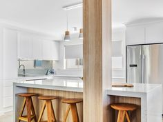 This clean white kitchen with contrasting natural oak finishes creates the perfect beach kitchen. Custom Kitchens, Bespoke Kitchens, Beach Kitchens, Quality Kitchens, Miami, It Is Finished, Natural, Table, Furniture