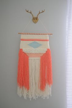 Coral Woven Wall Hanging by aladyandaloom on Etsy. Love the antler hanger