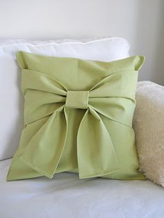 Bow pillows... I've seen these before but never cared for them. But I really like this one..