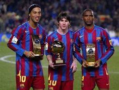Ronaldinho, Messi and Etoo of Barcelona hold trophies (AFP)