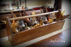 An old toolbox, Mason jars, feathers, branches, leaves -- whatever you have available!