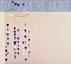 DIY Baby Mobile. Felt triangles, embroidery hoop and some floss. 2 hours at most to make. Super easy, super cute!!! #geometric #diy #baby