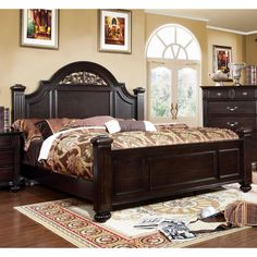 Elegant in every visual way, this four poster bed features an oval headboard that showcases a beautiful floral design along the arching open panel while the fluted bed posts are sturdily upheld by detailed bun feet.