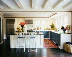 The kitchen of Tom Dolby and Drew Frist of Stone Road Vintage. White subway tiles and black cabinets.