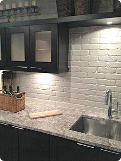 Kitchen   Painted Brick Backsplash,  Dark wood cabinets.  Beautiful!