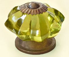 Yellow-green glass is grounded by bronze-toned metal in this Green Glass Knob from World Market; , $9.98 for two.