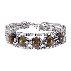 The bracelet is made in silver-tone finish and features embossed and beaded detail. Clasp closure. It will be a great accessory in your daily life.