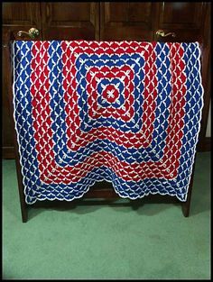 """Beautiful Shells Blanket #3"" done in worsted weight acrylic yarn in Cherry Red, White, and Royal Blue; 40"" x 40"". $110 at http://www.ritamiller.com/afghans/ar216-03.html."