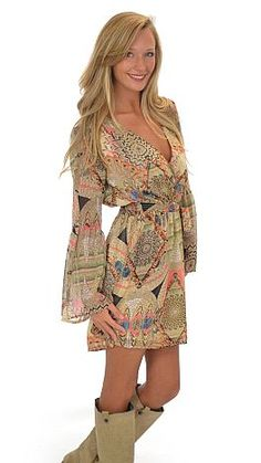 Flattering, affordable and perfect with boots.  This dress is allll that and then some :) $34 at The Blue Door Boutique