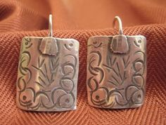 Ethnic arched forged sterling silver earrings by JewelryByCynthia
