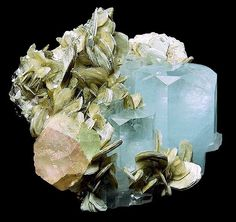 Beryl var. Aquamarine with bi-color Fluorite on Muscovite and Albite. It is unusual to find aquamarine and fluorite together with a whole   Fluorite crystal. This one is really nice and the Fluorite displays pretty pink with just a light touch of green.