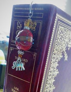 Never forget your page again with this beautiful Elephant Bookmark, lovingly handmade in Northern Ireland with silver-tone, Indian glass and ceramic beads complimenting a Tibetan style marker. The elephant is said to be a symbol of good luck, it is also said that elephants never forget, This Elephants Never Forget, Never Forget You, Ceramic Beads, Northern Ireland, Markers, Compliments, Symbols, Indian, Unique Jewelry