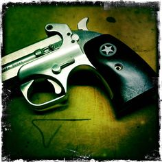 Bond Arms derringer with custom mother of pearl inlayed grips By: Todd Korup (a.k.a. The Uker of OZ)