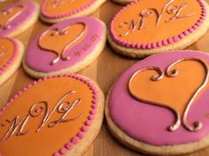 Awesome monogram & heart cookies with the wedding date hand painted on.