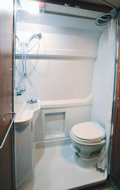 "Tiny bathroom - In a very limited space, this sort of ""wet room"" bathroom makes a lot of sense."