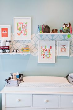 Stenciled nursery wall above the changing table - love the look!