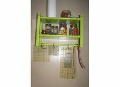 A paper towel/ toilet paper holder that I spray painted to mounted on the wall above my sewing station.  It holds my flex ruler, several quilting rulers, various clips and pins, as well as other tools for working with fabric.