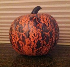 Cover pumpkin in lace, spray paint, and remove lace!