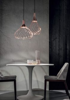 Refined lightness wrapping lines. Organic self-wrapped structure, in two shapes: one, more open and airy, the other streamlined. A name evoking visual..