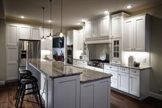 Nice-looking 3 Hanging Kitchen Lights Over White Wooden Panels Island Bar And Gray Dark Mosaic Granite Top With Black Kitchen Counter Height In White Kitchen Design