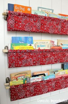Love these floating shelves for storing books. Maybe I can add clips to the front to hang my kids' artwork in rotation?