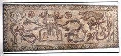 The Roman-British Oceanus Mosaic, AD 300-400; the sea god Oceanus/Neptune is depicted with his symbolic attributes, a trident and sea creatures. (British Museum)