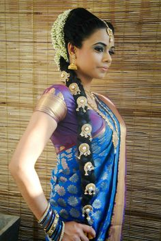 Traditional Indian bride wearing bridal saree and jewellery. #hairstyle
