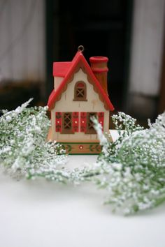 This teeny, tiny chalet ornament makes me want to curl up by a fire with cocoa!