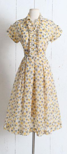 """➳ Vintage 1950s Dress Darling hashtag print dress. Semi-sheer crepe fabric, button front tuxedo ruffle, metal side zipper. Grey and yellow on off-white background. Adorable! Excellent condition - no flaws. Fits like XS/S. Length 46"""" Bodice 17"""" Bust 36"""" Waist 26"""" 1.5 hem ➳ shop"""