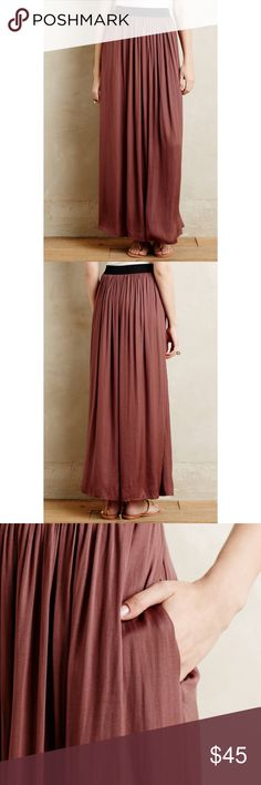 Sam & Lavi Anthropologie Kasba Maxi Skirt Beautiful silky flowy maxi skirt from Anthro by Sam and Lavi. Id say it fits more like a medium because it runs loose in the waist. Woven Polyester; Polyester, Spandex Lining. Front Slit. Pull-On Styling. Dry Clean. Imported. The original product description said it was brown...it's definitely more of what I would describe as amethyst. More of a purple tone than brown in my opinion. Anthropologie Skirts Maxi