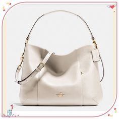 """HP 4/15 🎉👏 Authentic Coach East/West Isabelle Authentic Coach East/West Isabelle Shoulder Bag in pebble leather. Style F35809. Color- White Chalk w/ light gold hardware. New with tag. Dimensions- 14"""" L (bottom) x 11"""" H x 3"""" W  and 5"""" handle drop height w/ removable/adjustable long strap of 25"""" height for crossbody wear. Has multiple inside pockets (zip pocket & slide pockets) & external zip front pocket. its a top zip closure bag w/ fabric inside lining. No dust bag included. Last pic is…"""