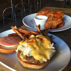The Oscar Burger (a burger topped with crab and Hollandaise sauce) mix the Sriracha and garlic sauces together. Pinterest: emzigrace