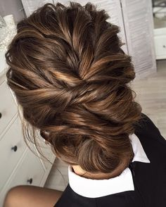 amazing loosely braided low bridal updo