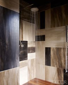 Large-scale mosaic tiles and a teak floor make this a pretty fabulous shower!