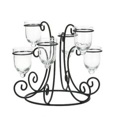 Fill each vase with large blooms and surround the bottom with more flowers? Amazon.com - Wrought Iron Candle Display $8. 9.5inches high x 11 inches wide