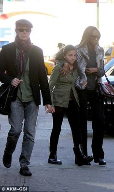 Bowie made clear he embraced conventional — or relatively conventional — family life with Iman largely to give his daughter Lexi (pictured centre) a normal upbringing